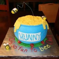 Pooh's Hunny Pot I did this for a little girl's first birthday. Took five round cakes and carved the pot. Icing is BC. Bees are made from gumpaste. The...