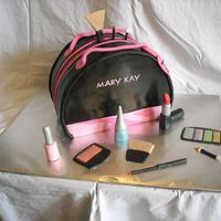 "Mary Kay Cosmetic Bag With Makeup Used 3 10"" round and cut off 2"" for the bottom to stand up. Vanilla cake with chocolate mouse filling. Yummy. Used MMF for all..."