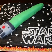 Star Wars Lightsaber All bc icing except for lightsaber. I carved cake to the right shape and covered in fondant with fondant details. I used red and yellow bc...