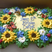 Garden Birthday Cupcake Cake 24 cupcakes decorated in BC. butterflies, bumble bee and ladybug are fondant.