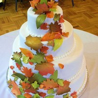 Fall Wedding covered in fondant with gumpaste leaves painted with an airbrush