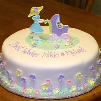 Baby Shower a Wilton design. covered in fondant with royal and fondant accents.