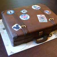 Vintage Suitcase wedding shower for 2 people who love to travel. covered in chocolate fondant with painted accents and edible image stickers.