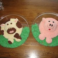 Cow And Pig I made these cakes for my son's 2nd birthday. They both consist of a round cake pan for the base, the Wilton ball pan for the head,...