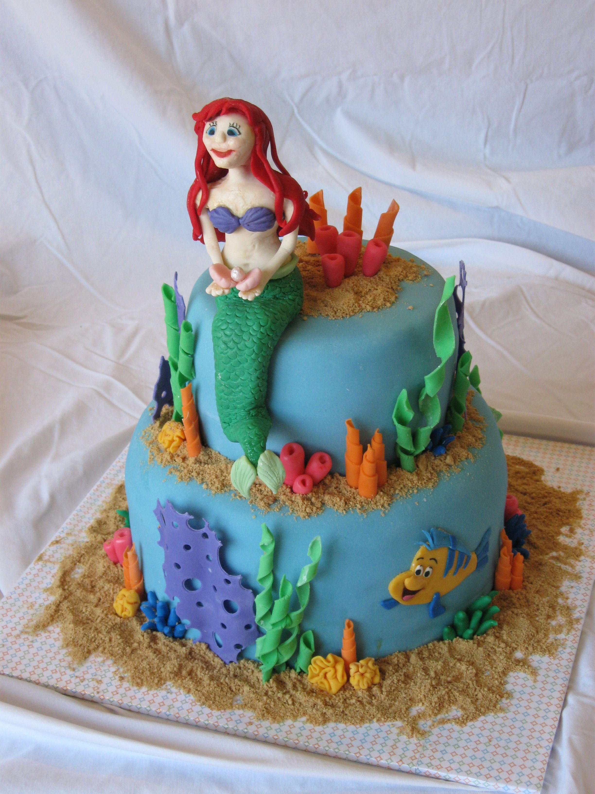 Little Mermaid Cake This was for my daughter's 7th birthday. She has been obsessed with the Little Mermaid since she was 3. Ariel didn't turn out...