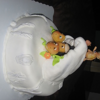 Ice Age Dawn Of The Dinosaurs  Vainilla Pound cake, Vainilla buttercream and almond fondant. Topsy turvy for a Kid who love those three dinosaurs from the movie. Rice...