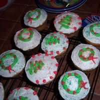 Cupcakes For Christmas I got the idea for these from Cakery. Cakery's cupcakes were very cute. I made the buttercream mint flavored for a more holiday flavor...