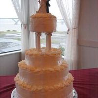 White On White Rose Wedding Cake This is my very first wedding cake. It is buttercream with a white buttercake raspberry and bavarian cream filling.