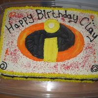 Incredibles Logo Buttercream frosting. This was hard. I tried to make red frosting, no luck without bad taste. I used red sugar. I think the point gets...