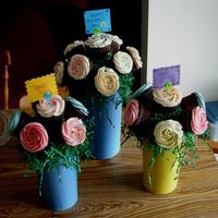 Cupcake Bouquet This is my rendition of Cambo's cupcake bouquet...I still need to practice but it's not bad for my first try...As you can see the...