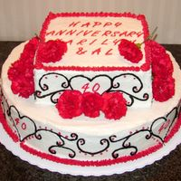 40Th Anniversary I made this cake for a 40th anniversary party. The cake is vanila and it's frosted with buttercream. The red and balck frosting was...