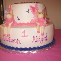 Fairy Birthday First birthday cake for twin girls. Princess fairy theme. Cake is covered in buttercream, fairies are 50/50 with gelatin wings.