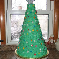 "Christmas Tree Cake  This was a large tree cake - 14"" bottom tier all the down to a 3"" tier. Made for a Christmas party for military families. Trimmed..."