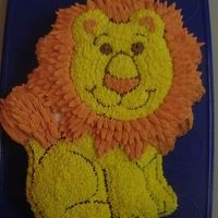 Wilton's New Friendly Lion Pan Isn't this pan cute? I just love it. My son wanted this pan, so we brought it home and made one up. I added a little depth to the mane...