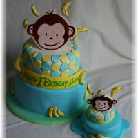 Mod Monkey one layer banana the other coco loco. accents made with gumpaste or fondant.thanks for looking