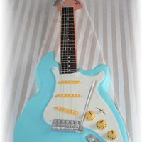 Fender Stratocaster Guitar Made this guitar for my sister in laws brother's 40th LOL!!gumpaste and fondant accents ...everthing was edible except for the strings...