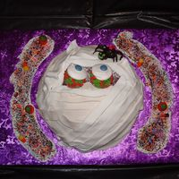 "Wilton Mummy Cake Wilton Mummy Cake ""All Wrapped Up"". My 8 y.o. son had a blast helping with this. This was one of the easiest Cakes I've ever..."