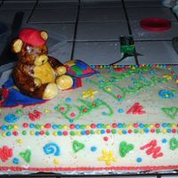 Primary Color Baby Shower This was my first project with fondant and I had a blast. The bear is made out of fondant and then painted with frosting tint colors. The...
