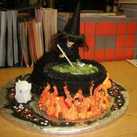 Witch's Brew Witch (made using Wilton's wonder mold) stooped over a swirling cauldron. Cauldron made from two bowl shaped cakes. Brew is made of a...