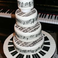 "Piano Sheet Music Tiered Cake This was a last minute throw-together for the 2007 San Diego Cakes on Parade Show and Competition. Cake covered in fondant, ""sheet..."