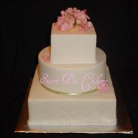 Spring Delight 12, 10,6 display cake. MMF, satin ribbon, silk hydrangeas, pearl border, diamond impression. Inspired by Sugarshack. Thanks for Looking!
