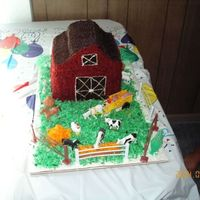 Farm Cake this was my very first cake for my sons 1st bday. boy did my hand hurt :)and the amount of red coloring...yikes! coconut hay and grass...it...