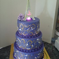 Prom  They asked for purple fondant with gold swirls and an eiffle tower! I immediately panicked over the tower, but after starting to make it...
