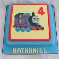Thomas The Tank Engine   Not much I can say about this one! All made with fondant. :-)