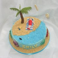 Betty Boop On The Beach!   A customer could choose between a Betty Boop cake or a beach cake for her daughter, so we had Betty on the beach!