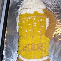 Cheers!  a beer mug made from the golf bag pan. chocolate cake with buttercream frosting. Made very quickly - a friend was coming to visit and i...