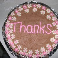 Thanks   yellow cake with chocolate buttercream frosting and buttercream decorations.