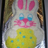 Easter Bunny With Egg  White cake with sprinkles inside to give it a spotted look, buttercream frosting. I didnt have much time for this one but it came out good...