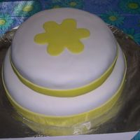 Yellow Flower   top layer 8in white cake -bottom layer 12in lemon cake covered in MMF