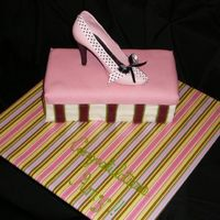 Shoe Box Cake  B/C frosting with MMF lid. Shoe is made of white chocolate. Cracks and holes in shoe are well disguised with ribbon and bow! :-) I put a...