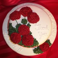 Red Geraniums   Cake covered in MMF. Flowers made with Royal icing.