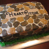 Herathstone cake made for a neighborhood function that copies the stone sign at the entrance. buttercream with fondant 'rocks'