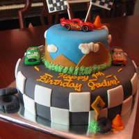 "Cars ""cars"" themed cake. marshmallow fondant over buttercream. All fondant accents except for the 3 cars"