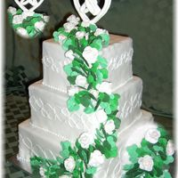 Irish Trinity Knot Cake This cake ws designed around the Irish Trinity Knot. It is a fondant covered cake with a royal icing cake topper in the shape of the...