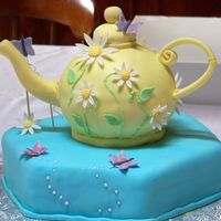 80Th Bithday Teaparty Cake Teapot cake for an 80th birthday teaparty. Lemon poppy seed, with lemon buttercream and covered in fondant. Flowers, butterlies, handle and...