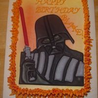 Darth Vader  I just delivered this cake. I borrowed an idea that I found on this website - the flame border. Done with orange-colored buttercream with...