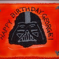 "Darth Vader Cake  This was done in white buttercream and sprayed red and orange for a ""firey"" look. The head was actually a seperate cake on top of..."