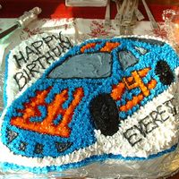 Racecar Cake   This was for my nephew's 4th birthday. Made with a Wilton pan and buttercream icing.