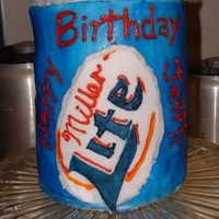 Miller Lite Can Cake  This was for my husband's birthday, and he loved it. I used four six-inch round pans and four different flavored cakes. It is covered...