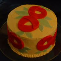 Mary Engelbreit Cake   I used a moon shaped cookie cutter and overlapped 3 pieces for the flower. Easy and cute!