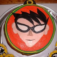 Teen Titans Robin Cake  This was for my son's 5th birthday. I made Robin's face out of flesh-tone,black and white fondant. I also made cupcakes to look...