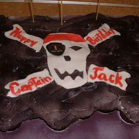 Pirate Flag Pull-Apart Cake  This was for my son's Pirates of the Caribbean birthday party. There are about 41 buttercream-iced cupcakes which were airbrushed...