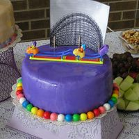 Roller Coaster Cake Fourth in my series of 5 retirement cakes. Covered in purple MMF and trimmed with gumballs. Topped with a plastic toy I found at the $...