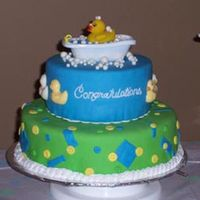 "Rub A Dub Ducky  This was for my cousin's baby shower. The cakes are 8"" and 12"", french vanilla layers with buttercream covered in MMF. The..."