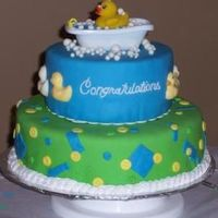 A Ducky Shower For Baby Zachary The cake was french vanilla cream with hazelnut buttercream icing and decorated with marshmallow fondant. Everything is edible except for...