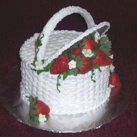 A Basket Of Berries For Mom  This cake was created at the request of my mother. The layers were lemon cream and were torted and filled with seedless strawberry jam....
